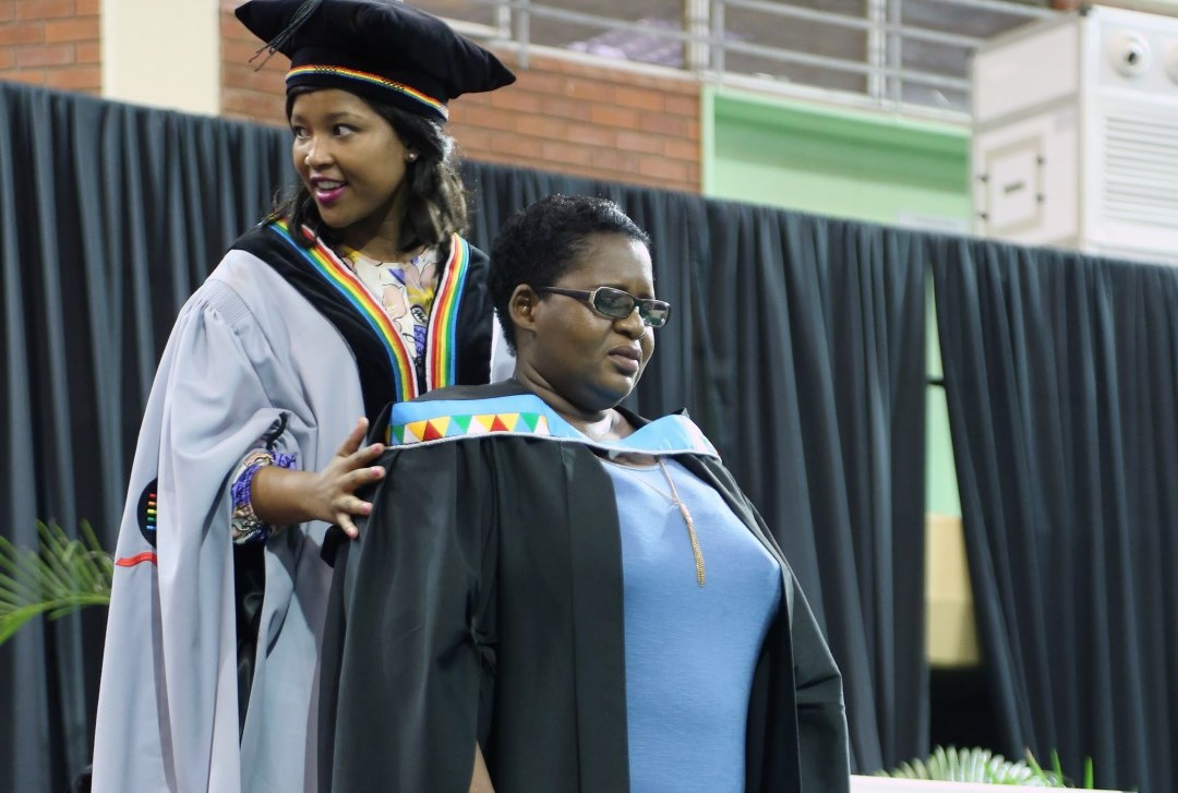 Ms Ntombizodwa Chiya graduates with her honours in education.