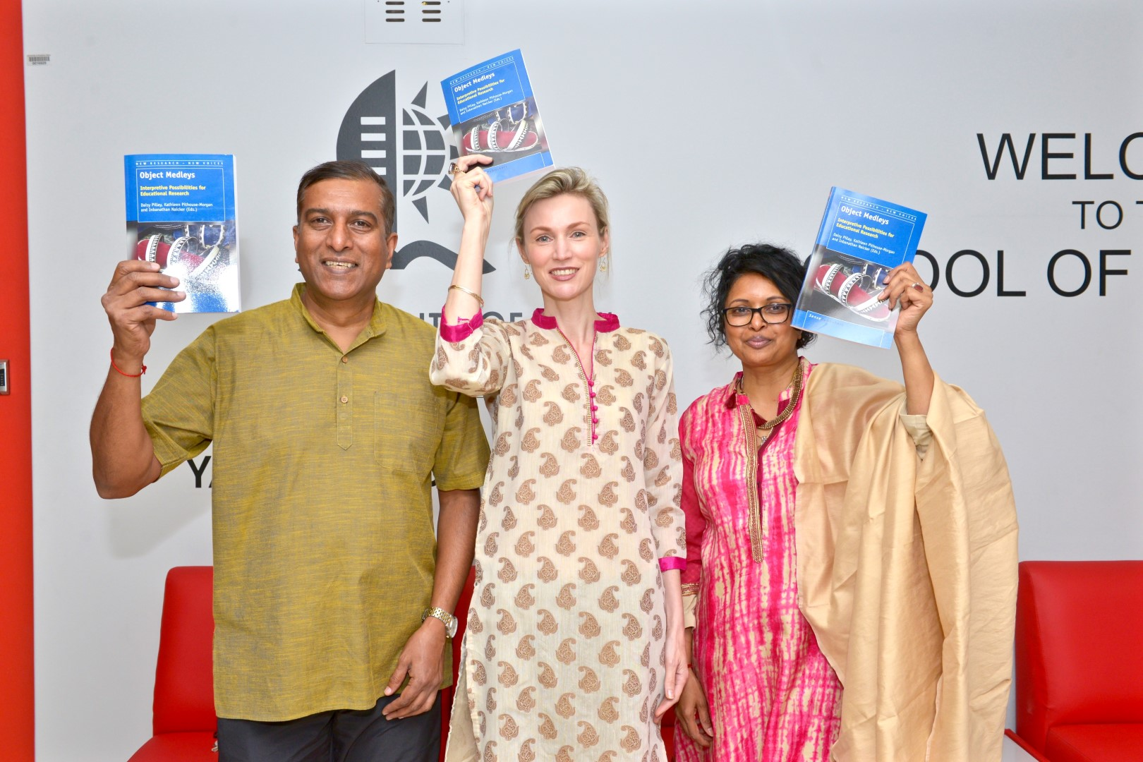 With their new book, from left is Dr Inbanathan Naicker, Professors Kathleen Pithouse-Morgan and Daisy Pillay.