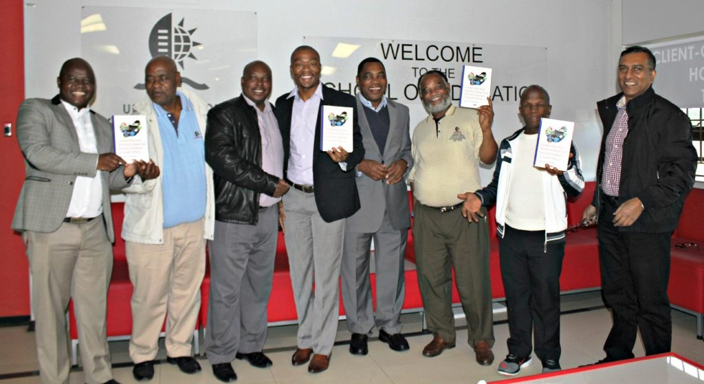 Education academics seen with their new book titled Leadership that Works in Deprived School Contexts of South Africa.