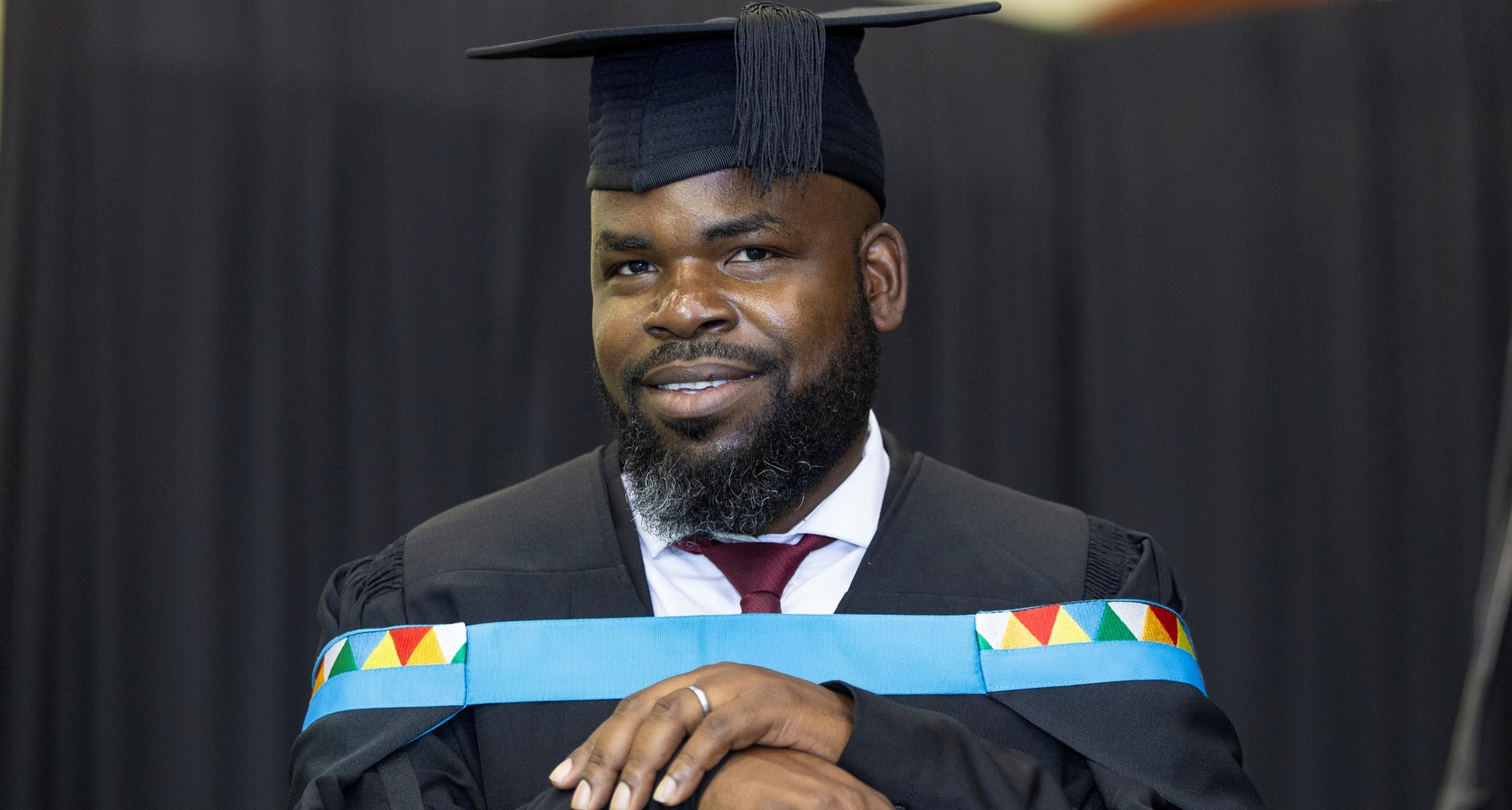 Mr McDonald Mnelemba graduates summa cum laude with his Master's in Education.