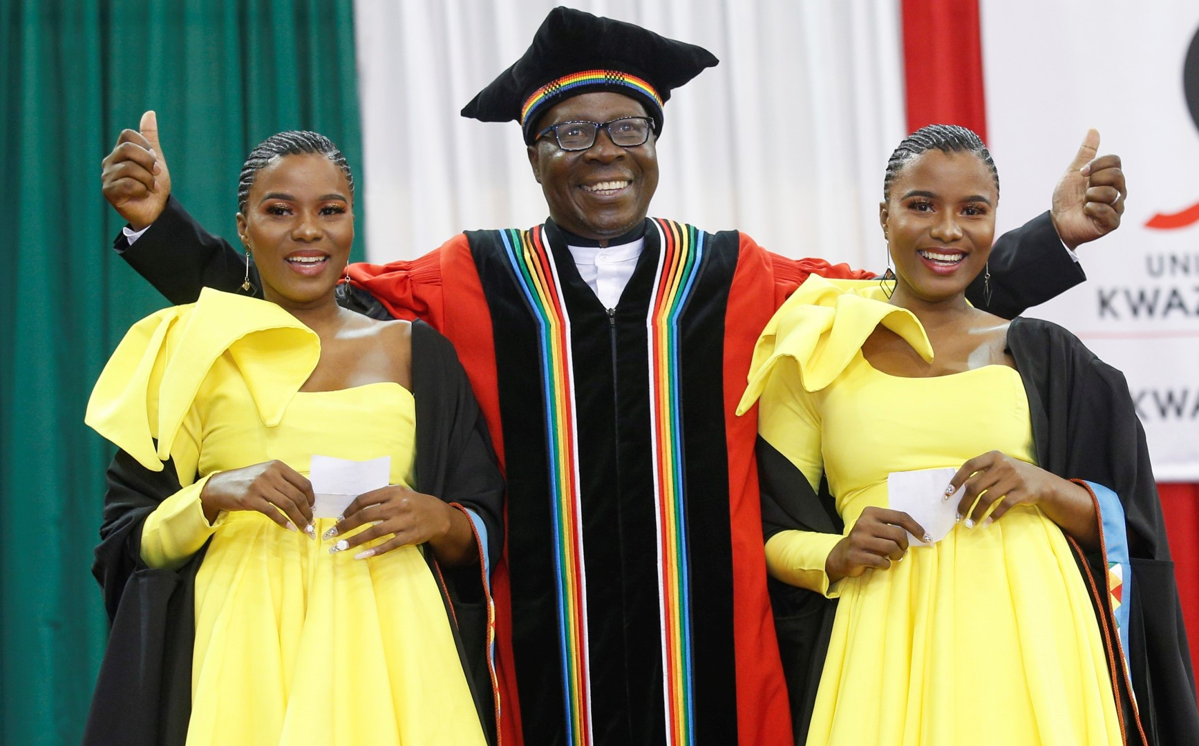 Twins Wanele and Anele Ngcobo graduate from UKZN with Postgraduate Certificates in Education. They are seen with DVC College of Humanities Professor Nhlanhla Mkhize