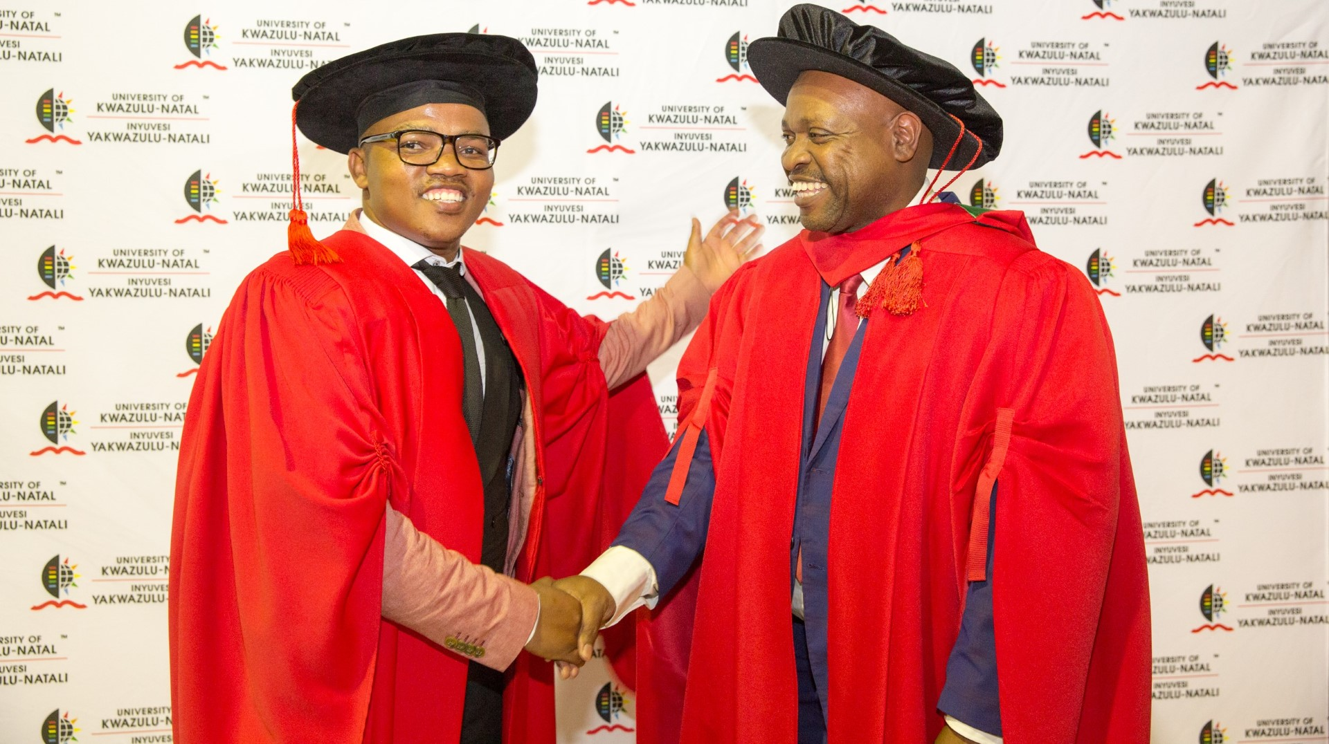Supervisor Dr Phumlani Myende and his student Dr Themba Mkhize. Supervisor Dr Phumlani Myende and his student Dr Themba Mkhize.