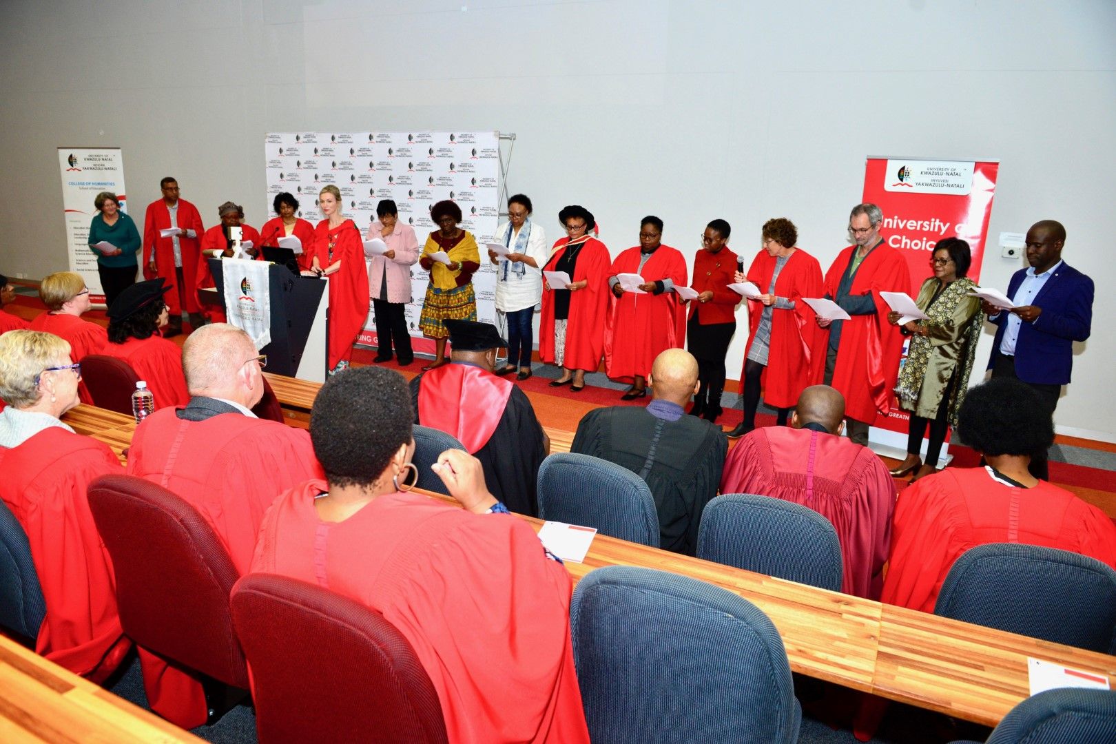 Professor Kathleen Pithouse-Morgan, presenting with (from left) Dr Jean Stuart, Professors Inbanathan Naicker, Relebohile Moletsane, and Daisy Pillay, Dr Anita Hiralaal, Professor Theresa Chisanga, Ms Makie Kortjass, Dr Delysia Timm, Dr Lungile Masinga, Ms Nosipho Mbatha, Dr Bridget Campbell, Dr Chris de Beer, Professor Nithi Muthukrishna and Mr S'phiwe Madondo.