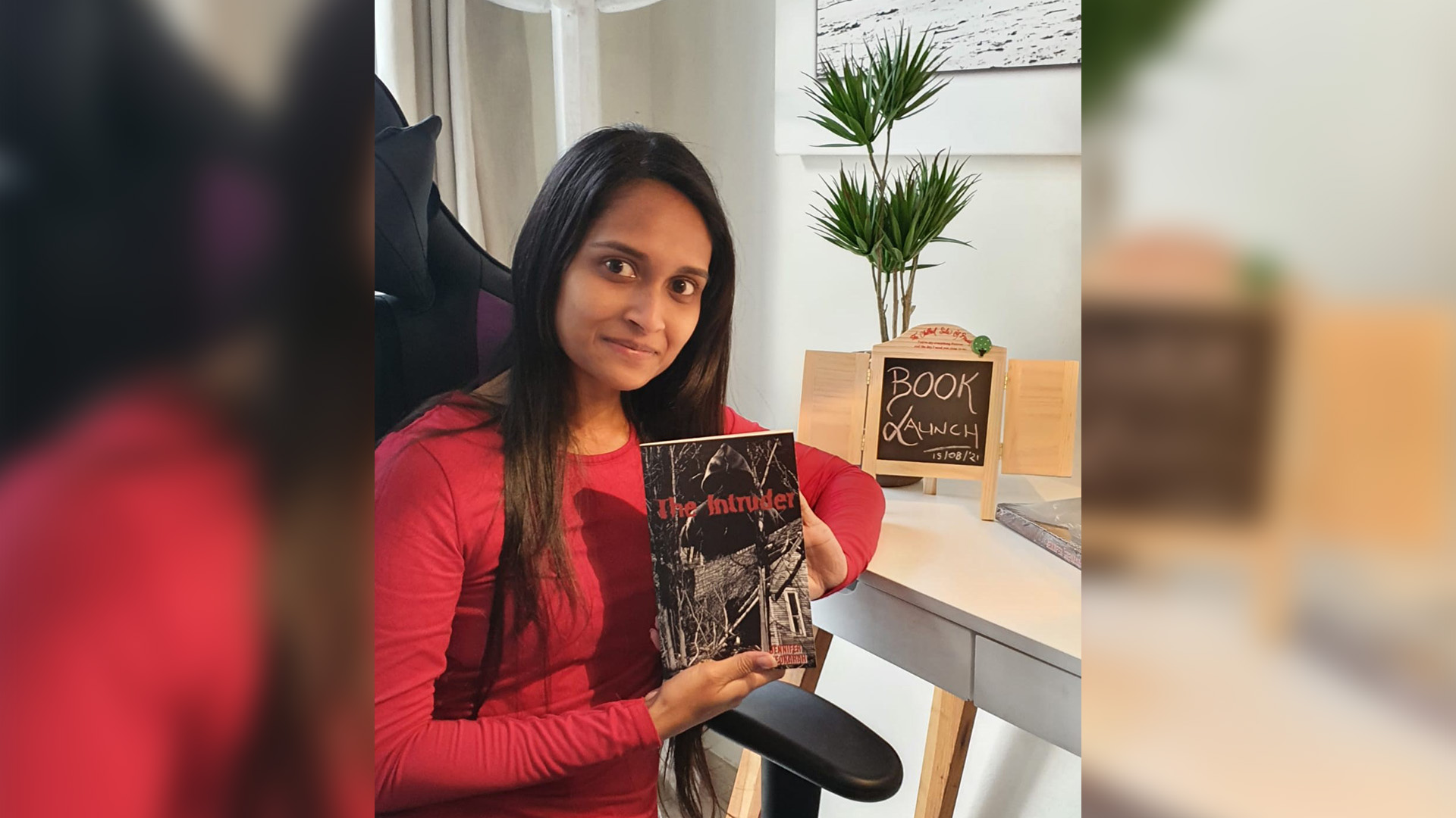 PhD in Education student Ms Jennifer Sheokarah with her new book The Intruder.